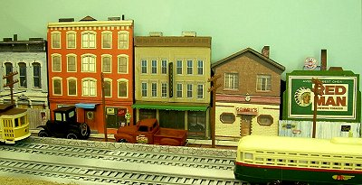 Click to see Howard Lamey's February, 2008 article that describes how to use our store front grahics to make a believable downtown district in any scale.